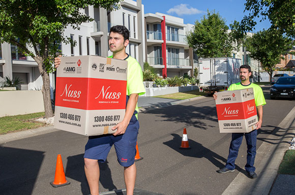 Removalists loading truck with boxes