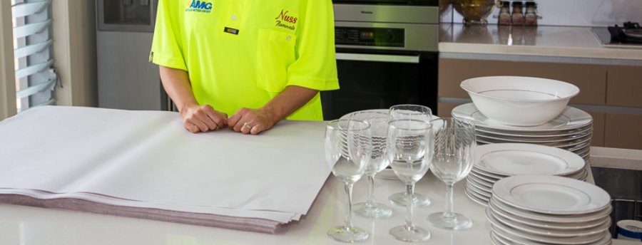 Removalist wrapping kitchen ware with packaging materials