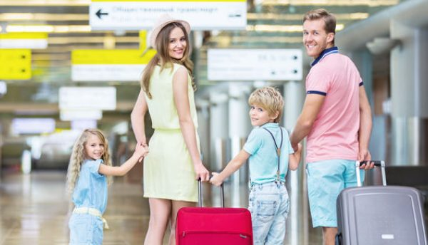 family at airport moving overseas