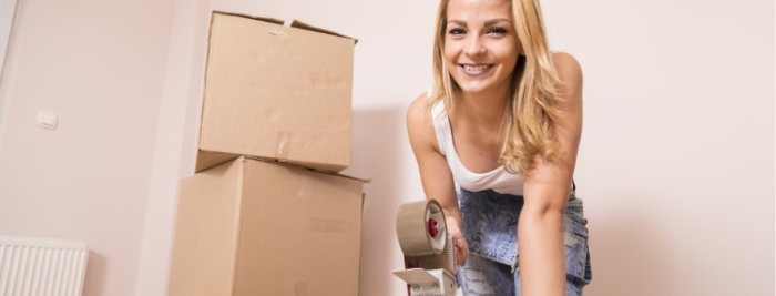 young lady packing moving boxes